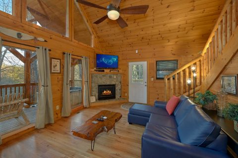 Cozy living room with fireplace in cabin - Running Creek