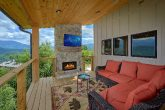 Large Covered Back Deck with Fireplace and TV