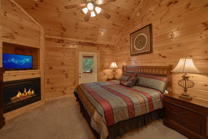 Master Bedroom with Fireplace and King Bed - Smoky Mountain Lodge