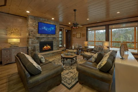 Living Room with Fireplace in 15 bedroom cabin - Smoky Mountain Masterpiece