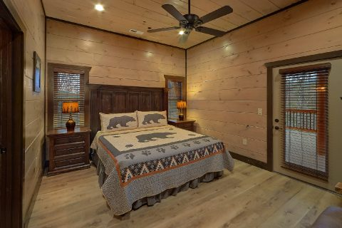 Cabin bedroom with King bed and private bath - Smoky Mountain Masterpiece