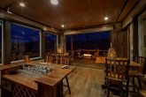 Bar with fire pits in 15 bedroom luxury cabin