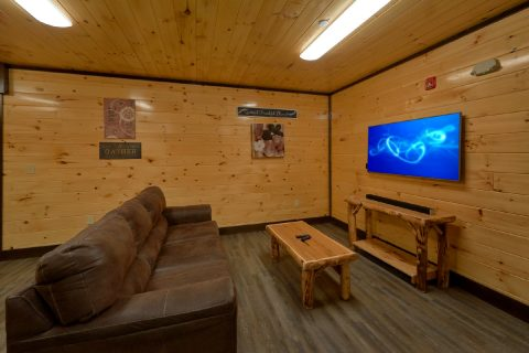Den area with TV in 12 bedroom cabin game room - Smoky Mountain Memories