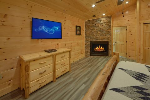 Cabin master bedroom with fireplace and king bed - Splashing Bear Cove