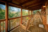 Honeymoon cabin with wooded view and porch swing