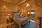 King bedroom with private deck access in cabin