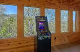 Arcade game in game room at 9 bedroom cabin