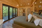 King bedroom with private deck in rental cabin