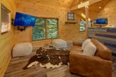 Living room with mountain views in rental cabin