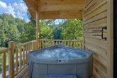 Treehouse cabin rental with hot tub on deck
