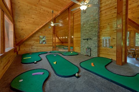 Luxury cabin rental with indoor putt putt course - The Big Lebowski