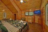Double King bedroom with TV in 11 bedroom cabin