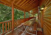 Pigeon Forge cabin with picnic tables on deck
