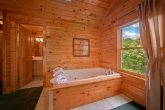 Cabin with corner jacuzzi and private bath