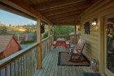 2 bedroom cabin with picnic table on the deck