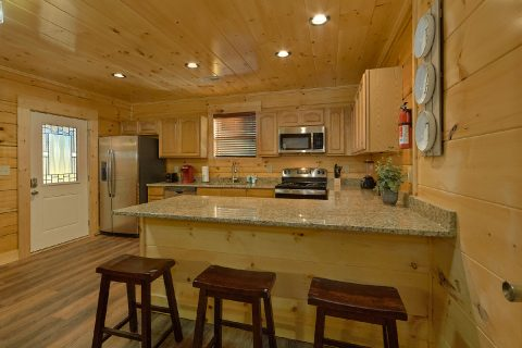 Spacious Kitchen with Extra Bar Seating in Cabin - Whistling Dixie