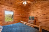 Master bedroom with King Bed and TV in cabin
